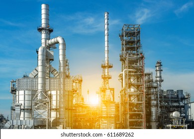 Pipelines and petrochemical industrial plant towers view of oil and gas refinery.