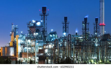 Pipelines and petrochemical industrial plant towers view of oil and gas refinery at sunset