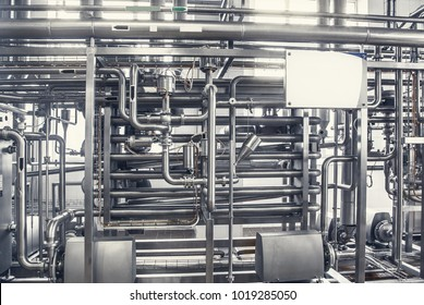 Pipelines from stainless steel, a system for pumping liquids or milk for the food industry. Abstract industrial background.