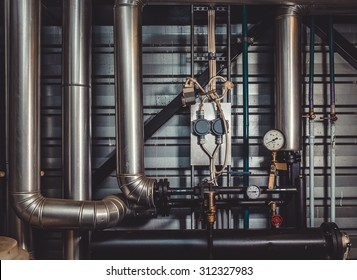 the pipes in the boiler room