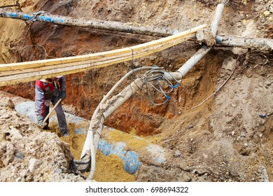Pipes and cables. Repair of communications. Water supply, electricity, Sewerage. Excavated roads in the city.