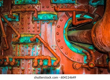 Pipes coming out of the furnace with all the rust and old bolts up close
