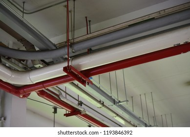 Pipes and ducts system under the cover walkway in the concrete building