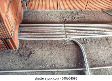 Pipes and heating system at house construction site. floor heating system, the collector and tools