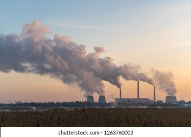 Pipes with heavy smoke in the industrial city in winter, Chelyabinsk, Russia.