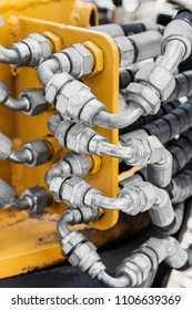pipes and the hydraulic system of the tractor or excavator.Focus on the left side of the frame on the pipes