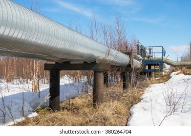 The pipes of the pipeline in spring against  blue sky