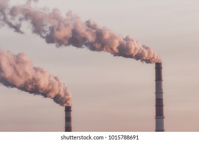 from the pipes of the plants goes dark harmful smoke