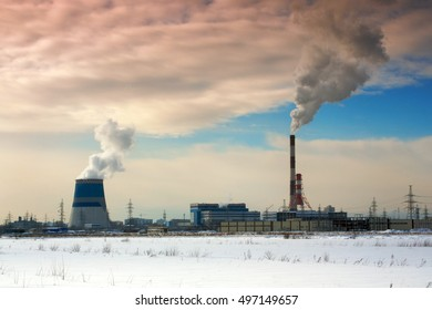 Pipes of thermal power station. Steam and smoke. Industrial factory landscape.