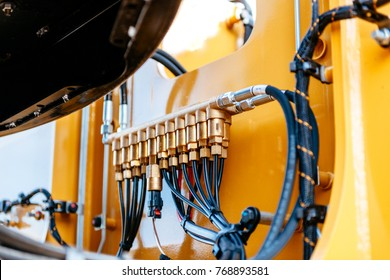 Pipes and tubes of the hydraulic system of a modern excavator tractor - engineering of powerful details of the work machine