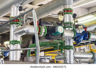 Pipes and valves in a boiler house, industrial object