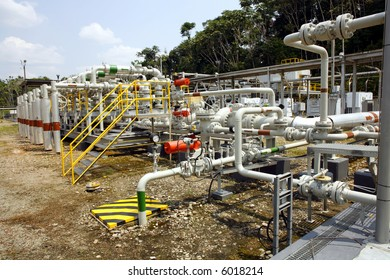 Pipes and valves on an oil well in the Amazon
