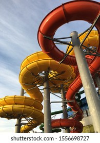pipes of the water park on the street in red and yellow