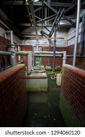 Pipework in the boiler room at a derelict lunatic asylum, Severalls, Colchester, Essex, England, UK