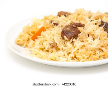 Piping hot pilau on a plate