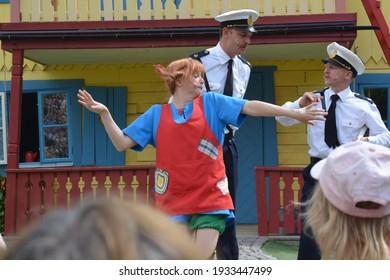 Pippi Longstocking performance at Astrid Lindgren's World theme park, Vimmerby, Sweden. Children's entertainment. Summer holiday. Space for copy.