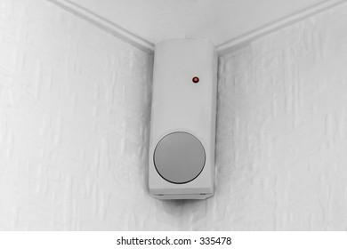 A PIR (passive infra red) movement sensor, part of a burglar alarm system