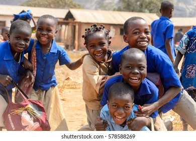 PIRA, BENIN - JAN 12, 2017: Unidentified Beninese children in school uniform have fun. Benin kids suffer of poverty due to the bad economy.