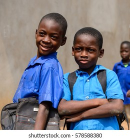 PIRA, BENIN - JAN 12, 2017: Unidentified Beninese little boys in school uniform. Benin kids suffer of poverty due to the bad economy.