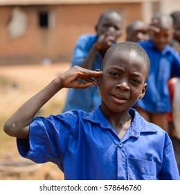 PIRA, BENIN - JAN 12, 2017: Unidentified Beninese little boy in a blue school uniform. Benin kids suffer of poverty due to the bad economy.