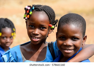 PIRA, BENIN - JAN 12, 2017: Unidentified Beninese little girsl in a blue school uniform. Benin kids suffer of poverty due to the bad economy.