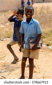 PIRA, BENIN - JAN 12, 2017: Unidentified Beninese boy in school uniform funhas . Benin kids suffer of poverty due to the bad economy.