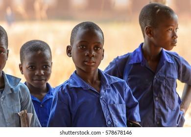 PIRA, BENIN - JAN 12, 2017: Unidentified Beninese children in school uniform. Benin kids suffer of poverty due to the bad economy.