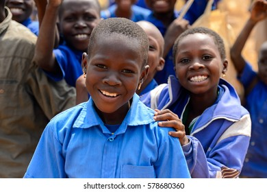 PIRA, BENIN - JAN 12, 2017: Unidentified Beninese children in school uniform smile. Benin kids suffer of poverty due to the bad economy.