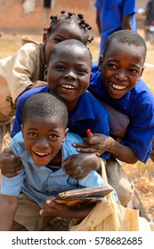 PIRA, BENIN - JAN 12, 2017: Unidentified Beninese children in school uniform have fun. Benin kids suffer of poverty due to the bad economy.