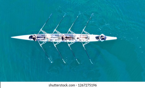 Piraeus, Attica / Greece - December 22 2018: Aerial drone bird's eye view of sport canoe operated by team of young men in port of Marina Zeas
