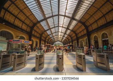 PIRAEUS, ATTICA, GREECE- JULY 2017. Inside the historical train (& metro) station at the port of Piraeus. Urban scenery with traffic of travelers and citizens in Piraeus city near Athens, Greece