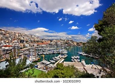 """PIRAEUS, GREECE- April 14, 2014. Mikrolimano (literally """"small port"""", old name """"Tourkolimano"""") & Kastella. View from the Nautical Club of Piraeus."""