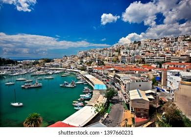 "PIRAEUS, GREECE- April 14, 2014. Mikrolimano (literally ""small port"", old name ""Tourkolimano"") & Kastella neighborhood."