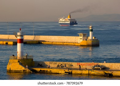 PIRAEUS, GREECE - AUGUST 09, 2013: Ferryboat leaving the harbor of Piraeus on April 09, 2014. The Port of Piraeus, as the largest Greek seaport, is one of the largest seaports in the Mediterranean Sea