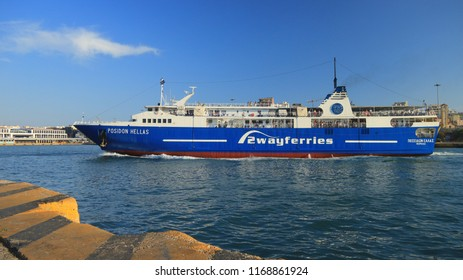 "PIRAEUS, GREECE, AUGUST 26, 2018. Passenger / RoRo ship ""Posidon Hellas"" of the ""2 WAY FERRIES"" shipping company arriving at the port of Piraeus, Greece."