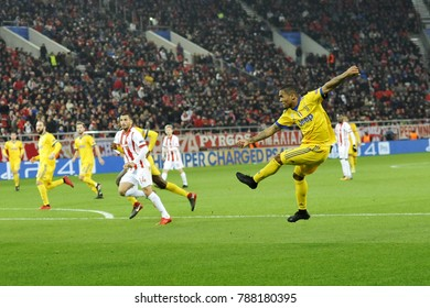 Piraeus, Greece - December 5, 2017: Juventus player Douglas Costa with the ball and Olympiacos Omar Elabdellaoui  during the game between Olympiacos vs Juventus at G. Karaiskakis stadium.