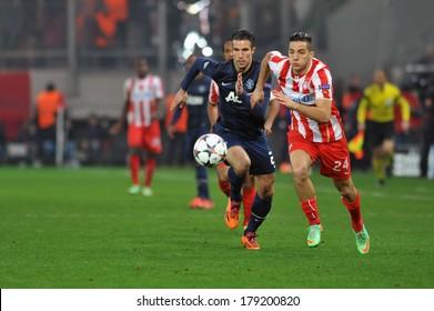 PIRAEUS, GREECE -FEB. 25. Olympiakos vs Manchester United 2-0. Olympiakos' Kostas Manolas (right) and Manchester United's Robin Van Persie (left) battle for the ball, in Piraeus, on February 25, 2014