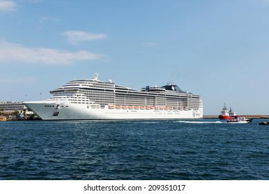 Piraeus, Greece - July, 24, 2014: Msc Fantasia is a cruise ship of Msc Cruises. Has built in 2008,Tonnage 137,936 GT, Length 333.3 m, Passengers 3,900 and Crew 1,313