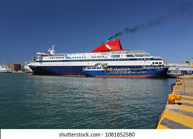 PIRAEUS, GREECE - MAY 04, 2015: Seaways Ferry Replenishment With Fuel From Eko Mandoudi Oil Tanker in Port of Piraeus, Greece.