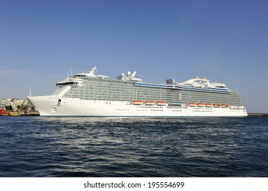 PIRAEUS, GREECE -MAY 27, 2014 Regal Princess, Royal class cruise ship owned by Princess Cruises, departs from Piraeus port. Ship was built in 2014 and has a capacity of 3560 passengers and 1346 crew.
