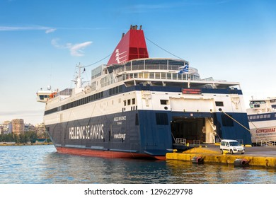 Piraeus, Greece - May 7, 2018: Large car-ferry docked in seaport near Athens. Big ship in a sea harbor. Ferryboat loading or unloading by a port pier. Concept of transportation and traveling.