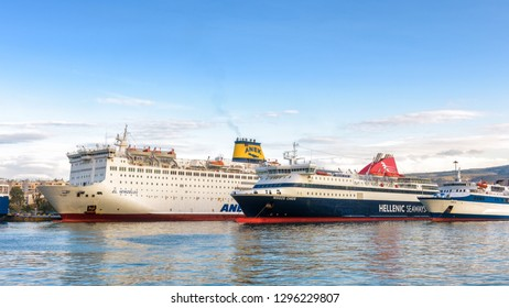 Piraeus, Greece - May 7, 2018: Large car-ferries docked in seaport near Athens. Panoramic view of the ships in sea harbor. Moored ferryboats in port in summer. Concept of transportation and traveling.