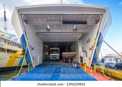 Piraeus, Greece - May 7, 2018: Car-ferry docked in seaport near Athens. Large ship in a sea harbor close-up. Ferryboat loading or unloading by a port pier. Concept of transportation and traveling.