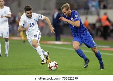 Piraeus Greece Nov.12, 2017 Player Ivan Strinic of the Croatia national football team and Greek Yannis Gianniotas (18) during the mach with Greece - Stadio Georgios Karaiskakis.