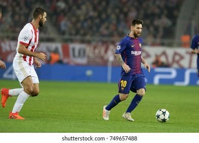 Piraeus, Greece November 2, 2017.  Lionel Messi (10) with the ball next to Panagiotis Tachtsidis (6) during  the champion league football game between Olympiakos vs Barcelona in Piraeus