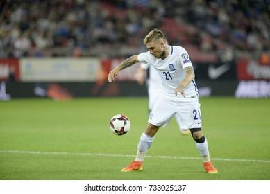 PIRAEUS GREECE OCT 10, 2017 Greece's Kostas Stafylidis with the ball during the  European qualifying match between Greece and Gibraltar at Georgios Karaskaikis stadium.