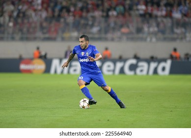Piraeus, Greece Oct. 22, 2014.Juventus Carlos Tevez, with the ball, during t the Champions League football match between Olympiakos vs Juventus (1-0) at Karaiskaki Stadium in Piraeus