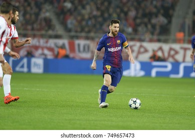 Piraeus, Greece October 31, 2017.  Lionel Messi (10) with the ball next to Panagiotis Tachtsidis (6) during  the champion league football game between Olympiakos vs Barcelona in Piraeus