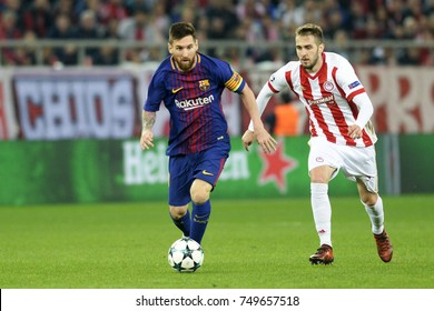 Piraeus, Greece October 31, 2017.  Lionel Messi (10) with the ball next to Kostas Fortounis (7) during  the champion league football game between Olympiakos vs Barcelona in Piraeus