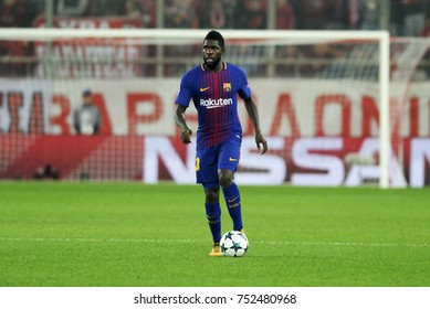 Piraeus, Greece October, 31, 2017.   Barcelona's Samuel Umtiti (23) with the ball in the champions league football match Olympiacos vs Barcelona in Piraeus.